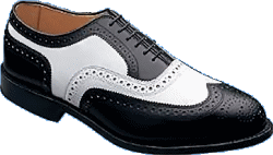 A black & white wingtip spectator shoe